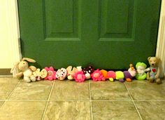 Draft Door Stopper made with stuffed toys. Such a great idea to repurpose old toys