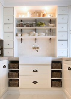 White kitchen, white backsplash, open shelves