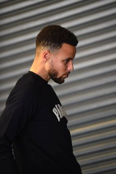 Stephen Curry of the Golden State Warriors looks on before the game against the Oklahoma City Thunder on February 6 2018 at Oracle Arena in Oakland...