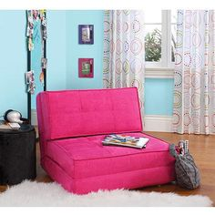 folds into a bed...less than $100 and takes up less space than a full futon.  other colors available as well :)