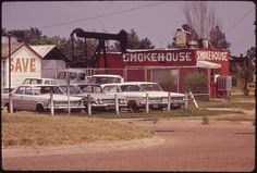 Oil Derrick beside Restaurant and Used Car Lot, 06/1972