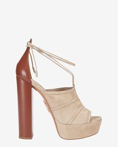 Aquazzura Very Eugenie Suede Platform Sandal: Soft neutral-tone suede and a soaring leather block heel make legs look miles long. Gold-tone metal tips at lace-up ties. Open toe. 6 heel and 1 1/4 platform. Leather sole. In beige suede/brown leather. Made in ... 775.00
