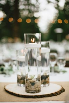 pebbles with votives...very nice! Photography By / http://memoirestudio.com,Planning By / http://feliciaevents.com