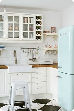 Love the floor and blue vintage Ice box