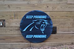 A personal favorite from my Etsy shop https://www.etsy.com/listing/266098424/carolina-panthers-signs-keep-pounding