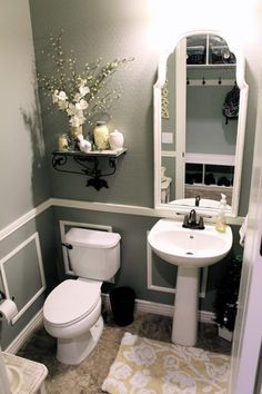 Grab a little bit of paint, upcycle an older mirror and add some faux wainscoating with a chair rail.. More Remodeled Bathroom Ideas | Inspiring Makeovers on a Budget on Frugal Coupon Living.