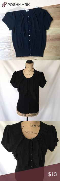 """NY&Co Black ruffled short sleeve blouse About: • brand: New York & Company • size: small • silky material for ruffles and sleeves • cute to pair with a pair of skinny jeans and heels   Measurements (are done by flat lay and are estimated): • bust: 34"""" • length: 22""""  #newyorkandcompany #nyandco #black #blouse #ruffle #shortsleeve #buttondown #office #interview #work #small #sizesmall #sizes New York & Company Tops Blouses"""