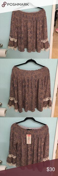 Off the shoulder floral bohemian shirt Very cute bohemian shirt! Comfy with elastic around the shoulders. 100% rayon. NWT. Tops Tunics
