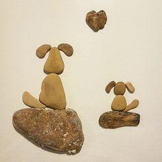 Beach pebble art 2 dogs