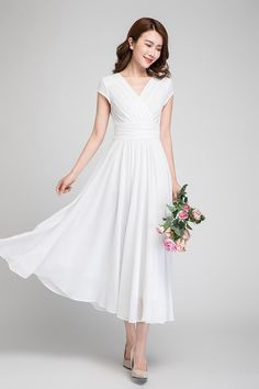 Our white chiffon maxi dress is styled with V-neck and banded empire waist  accented 80b56955e