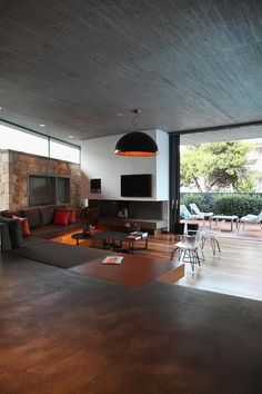 sleek-athens-house-blends-stone-with-concrete-textures-16-living-room-far.jpg