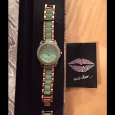 Heidi Klum Watch This Heidi Klum watch has been worn only 3 or 4 times. It's in like new condition. Mint green and rose gold tone. Very pretty and on trend. I had a few links taken out but I have them and they can easily be put back in. Heidi Klum Jewelry