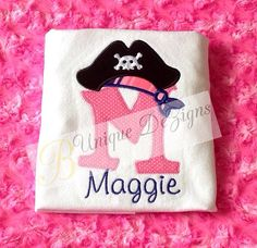 This listing is for 1 white T-shirt or bodysuit that has a pirate alphabet with a scarf and pirate hat. Comes in letters A-Z or numbers 1-9. This