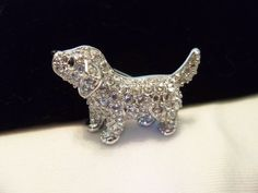 A personal favorite from my Etsy shop https://www.etsy.com/listing/459909660/swarovski-swan-labrador-puppy-dog-pave