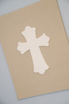 Linen covered canvas. Painted wood cross hot glued to the fabric for baby boy's nursery.