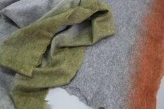 Felt shawls by Tumar Art Group. First presented at EUNIQUE in Karlsruhe. Handmade from finest merino wool, it doesn't irritate tender skin. Very thin. 220*94 cm. Colors: ocher, grey, blue, brick, black.