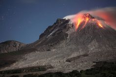 Glowing Dome of Soufriere Hills Volcano, Montserrat - Montserrat Island, Caribean - Soufriere Hills Volcano Incandescent Lava Dome viewed at Night. Photography by Richard Roscoe