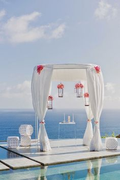 Minimalist ceremony decor at an ocean-front location