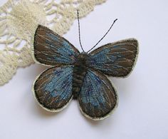 Embroidered butterfly brooch, 'Small Blue'.