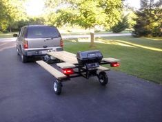 An eight foot picnic table with gas grill that can be towed behind car or truck. I love this.....