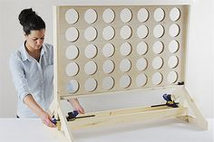Completing the assembly of a backyard game DIY project Home Project backyard DIY Backyard Game: Four-in-a-Row - The Home Depot Diy Yard Games, Backyard Games, Diy Games, Outdoor Games, Giant Yard Games, Woodworking For Kids, Woodworking Projects, Woodworking Desk, Games For Kids