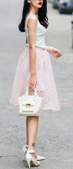 Pretty and sheer pink houndstooth skirt http://rstyle.me/n/jbbwdnyg6