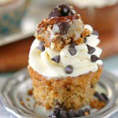My FAVORITE magic cookie bar in a cupcake! Super moist and super chocolatey.  Dripping with sweetened condensed milk
