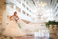We love this elegant photo of one Disney bride in the Grand Floridian lobby #Disney #wedding #photography #GrandFloridian. Photo: Ty, Disney Fine Art Photography