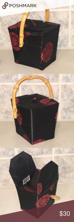 "Vintage Tozai Home Chinese Takeout Box Handbag Vintage Tozai Home Chinese Takeout Black Satin Box Handbag with natural tan Bamboo Handle. Red Satin Chinese Floral Design. Vintage from the 1980's. Interior is clean and solid black satin. Velcro top closure.  This little box purse is in excellent condition inside and out. Approx measurements: 5"" tall/4"" wide. This will be a conversation piece on your wrist. Make your statement! Tozai Home Bags"