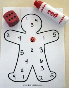 Outline of gingerbread man. Write numbers. Children roll the dice to see what number to dab