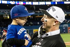 Tulo & his son Taz after the Jays sweep the Rangers and head to the ALCS. Beautiful picture taken by John Lott.