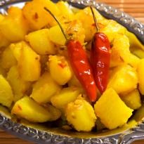 Bhapaa Aloo: Baby #potatoes in a distinctive five spice mix, steamed with mustard paste, curd and coconut.