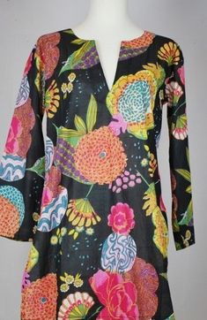 Light weight cotton tunics in colorful floral pattern and black background. Wear it with black trousers for a classy look. Runs small, best to size up Mid-thigh