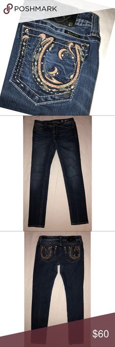 """Miss Me skinny jeans! Like NEW! Ride out in these Miss Me embellished horseshoe skinny jeans, styled with whiskering, contrast stitching, silver logo hardware, and dark wash in color. Only worn twice - LIKE NEW!   Waist measures 15"""" ⚜️ Inseam 31"""" ⚜️ Rise 8"""" ⚜️ Miss Me Jeans Skinny"""