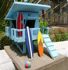 Nail adirondack chair on coffee table for lifeguard shack, hook for binoculars to watch this at the other end of the yard!the BEST birdhouse on Etsy bar none. Cubby Houses, Fairy Houses, Play Houses, Backyard Play Spaces, Backyard Playground, Bird House Feeder, Bird Feeders, Surf Shack, Beach Shack