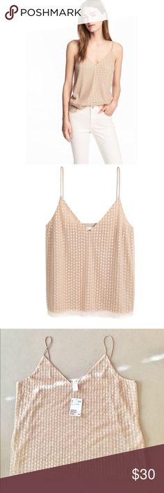 "Beautiful H&M Camisole sequins & beaded Mesh NEW! H&M Camisole top in beige. Very beautiful and delicate.  Sequined and beaded mesh with a V Neck and narrow shoulder straps. Brand NEW WITH TAG! 100% Polyester. 37 3/4"" Chest, stretchy. Size 12 fits a Medium to Large. Smoke and Pet free home. Make me an offer  H&M Tops Camisoles"
