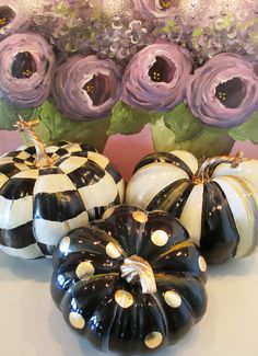 Set of three mid-sized hand painted pumpkins.  Love the combination of checks, stripes and polka-dots.