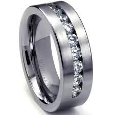 8 MM Men's Titanium ring wedding band with 9 large Channel Set CZ Sz This brush finish wedding ring is made from genuine titanium alloy and it features 9 large AAAAA+ grade cubic zirconia stones in channel setting. It is also made in comfort fit design. Black Titanium Wedding Bands, Titanium Rings For Men, Titanium Jewelry, White Gold Wedding Bands, Tungsten Wedding Bands, Men Rings, Wedding Bands For Him, Cool Wedding Rings, Custom Wedding Rings