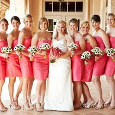 Coral dresses and white/ anemone bouquets
