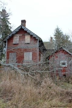 Abandoned red house with trim.