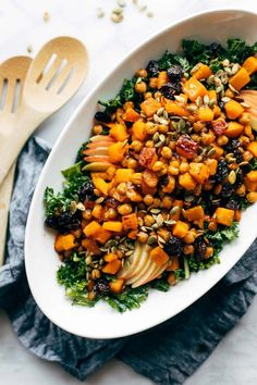 Squash Squash Salad with Kale and Roasted Garlic Dressing – the BEST Thanksgiving salad. Roasted garlicky kale, squash and chickpeas, crisp apple, dabbles of pepitas and dried cherries, and a drizzle of roasted garlic dressing over the top. Fall Recipes, Real Food Recipes, Vegetarian Recipes, Dinner Recipes, Healthy Recipes, Ramen Recipes, Healthy Salads, Pasta Recipes, Roasted Garlic Dressing