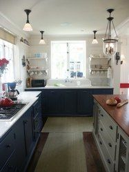 Great cottage kitchen.  Love the mixed finished and open shelving.