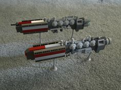 two government-owned freighter tankers. Incorporated into the T'ndari Imperial Fleet after being bought from their civilian owners.  The Nautilus (top) is a newer variant of the same design as the Alamos (bottom)  the communication arrays and defense systems differ.  I personally would say that the Nautilus (above) sports the heavier defense and longer-range communications.  Thanks to Word_Freak and [ Veda ] for the names.