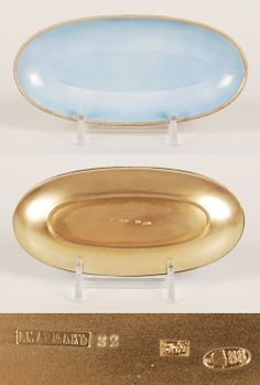 A Russian silver gilt and guilloche enamel oval tray, made by the 3rd Artel, St.Petersburg, circa 1908-1917. The slightly dished tray completely covered in pale translucent blue enamel over a textured engine turned ground within a gilt border.