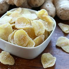 how to make homemade crystallized ginger recipe 1 pound peeled and sliced ginger, preferably young/smaller roots, sliced about ⅛ inch thick (by hand or use a mandolin) Pinch of salt 2 cups white granulated sugar Extra sugar for coating Crystalized Ginger Recipe, Recipe For Candied Ginger, Ginger Chews Recipe, Recipes With Ginger Root, Uses For Ginger Root, Ginger Ideas, Candy Recipes, Dessert Recipes, Vegan Recipes