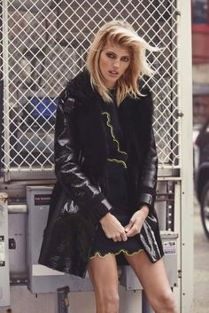 Posing next to a chainlink fence, Devon Windsor wears Versace jacket | EDITORIALS | RECOLLECT VINTAGE and dress