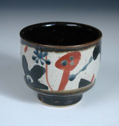 John Maltby (born 1936), a stoneware pot, of circular form raised on a foot, decorated with a ban