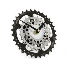 This Tread & Pedals Recycled Bicycle Gear Clock makes a great gift for cyclists and those who appreciate industrial design. Our upcycled Bicycle Clock has been handcrafted with care from a set of recycled bicycle gears finished with pair of black clock hands. This bike clock is sure