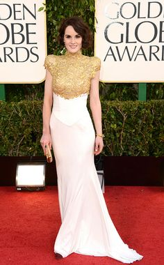 Golden Globe Awards 2013   From Downton Abbey to the red carpet, the actress channeled Lady Mary in a fall 2012 couture gown with a regal gold guipure bodice.