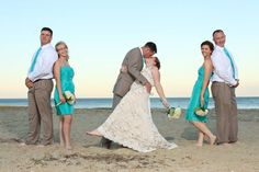 Love the color of the dresses and the way the groom/groomsmen are dressed.